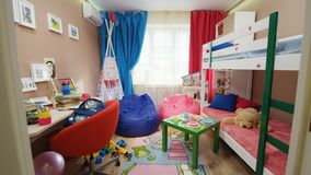 Motion to bright boy and girl children room with funny toys stock footage