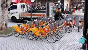 Motion of truck unloading public rental bike call ubike beside and stocking on road. Ubike is a popular network of rental bicycle in Taipei, Taiwan stock footage