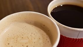 Motion of two cup of hot coffee on table at food court. In Taipei Taiwan stock video footage