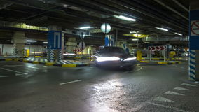 Motion in underground parking of hypermarket  ,time lapse stock footage