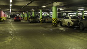 Motion in underground parking of ,shopping mall ,time lapse stock footage