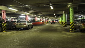 Motion in underground parking of ,shopping mall ,time lapse. Motion in underground parking of hypermarket ,shopping mall ,time lapse stock video footage