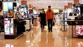 Motion of unidentified people shop at boutiques at the shopping mall. In Taipei Taiwan stock video footage