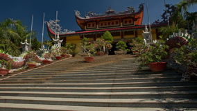 Motion up Steps to Buddha Pagoda Flowers Long Dragon stock footage