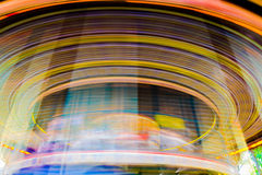 Motion of vintage merry-go-round carousel. Stock Images