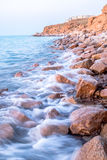 Motion waves at the rocky coast Royalty Free Stock Images