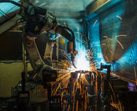 Motion Welding robots in a car factory royalty free stock images