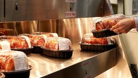 Motion woman buying bbq chicken. Inside Costco store stock footage