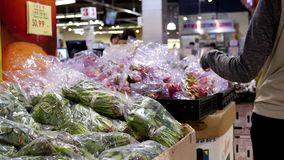 Motion of woman buying dragon fruit. Inside Chinese supermarket stock footage