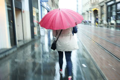 Motion of woman with pink ubrella Stock Photography