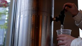 Motion of woman pouring water stock footage