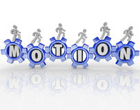 Motion Word Gears Workers Progress Forward. The word Motion in gears and people walking on them to move them to illustrate a team working together to move a Royalty Free Stock Photo