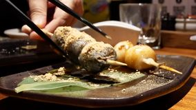 Motion of worker bowing down and thank you for customer. Inside Japanese restaurant stock footage