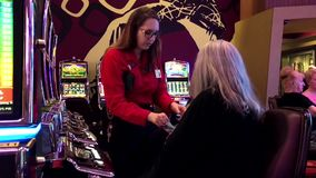 Motion of worker counting money for winner. Inside Hard Rock Casino stock video footage