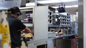 Motion of worker preparing burger for customer stock video