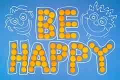 Motivación: Sea feliz Foto de archivo