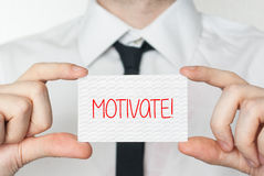 Motivate. Businessman holding business card Stock Images