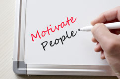 Motivate people written on whiteboard Royalty Free Stock Images