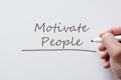 Motivate people written on whiteboard Royalty Free Stock Photo