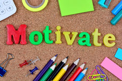 Motivate word on cork Royalty Free Stock Photo