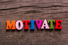 Motivate  word made of wooden letters Stock Photos