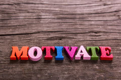 Motivate  word made of wooden letters Stock Images