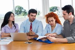 Motivated business team in discussion Royalty Free Stock Photos