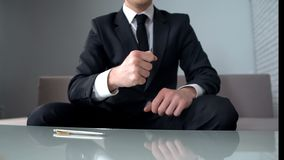 Motivated businessman clenching fists, confident of successful startup, winner. Stock photo stock photo