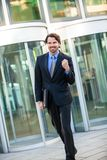 Motivated businessman punching the air Royalty Free Stock Photography