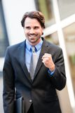 Motivated businessman punching the air Royalty Free Stock Photo