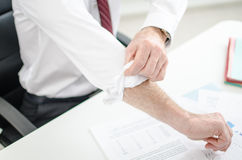Motivated businessman. Rolling up his sleeves royalty free stock photos
