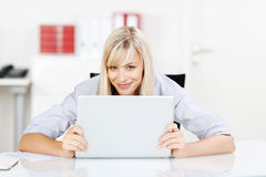 Motivated businesswoman in her office Stock Image