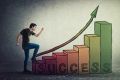Motivated and confident young man hurry to climb the stairway to success. Guy stepping on staircase as a rising graph. Ambitions. Concept of successful career stock photos