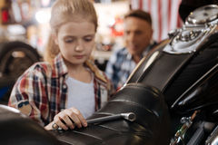 Motivated enthusiastic child repairing a bike like a pro Royalty Free Stock Photography