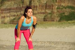 Fitness woman ready for running beach training Royalty Free Stock Images