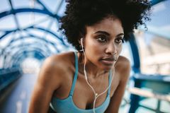 Motivated and focused woman runner royalty free stock photos