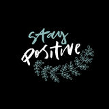 Motivated hand lettering phrase Stay positive. Vector hand lettering phrase stay positive with black background. Modern lettering. Contrast inscription Royalty Free Stock Image