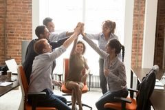 Motivated happy diverse office people group giving high five. Motivated happy diverse business office people employees group give high five with coach mentor royalty free stock images