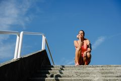 Motivated happy woman training outside stock photos