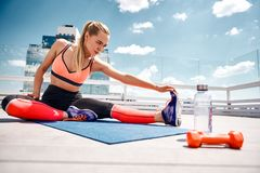 Motivated lady is exercising on rooftop royalty free stock photo