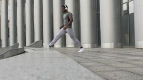 Motivated man calmly stretching before workout session, slow-motion warmup. Stock footage stock video