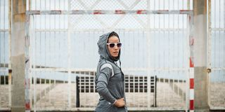 Urban sporty woman on outdoor fitness workout royalty free stock photos