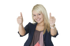 Motivated woman giving double thumbs up. Motivated enthusiastic young woman giving double thumbs up of victory and success while smiling gleefully in celebration stock images