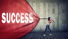 Motivated woman pulling a red banner with success word overcoming a failure stock photos