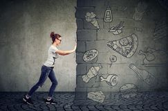 Free Motivated Woman Resisting Temptation Of Eating Fast Foot And Choosing Better Diet Royalty Free Stock Photo - 116962655