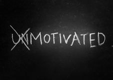 Motivated. The word unmotivated crossed out to reveal motivated royalty free stock photos