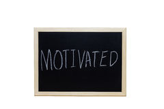 MOTIVATED written with white chalk on blackboard Stock Photography