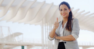 Motivated young woman giving a thumbs up Stock Photo