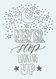 Motivating hand lettering poster. Motivated hand lettering phrase Never stop looking up. With nice sketch and Light-blue back Royalty Free Stock Photos