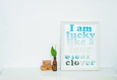 Motivating poster. Motivating grunge wooden poster quote i am luckylike a four leaf clover Royalty Free Stock Image